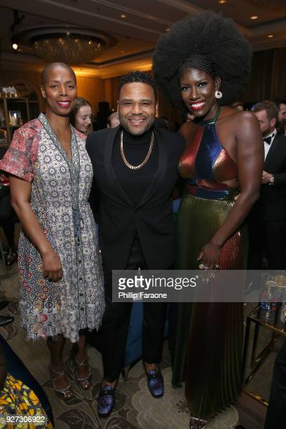 Actors Tasha Smith Anthony Anderson and executive Bozoma Saint John attend MercedesBenz USA Official Awards Viewing Party at Four Seasons Beverly...