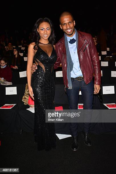 Actors Tashiana Washington and Eric West attend the Vivienne Tam show during MercedesBenz Fashion Week Fall 2014 at The Theatre at Lincoln Center on...