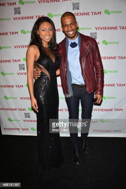 Actors Tashiana Washington and Eric West pose backstage before the start of the Vivienne Tam show during MercedesBenz Fashion Week Fall 2014 at The...