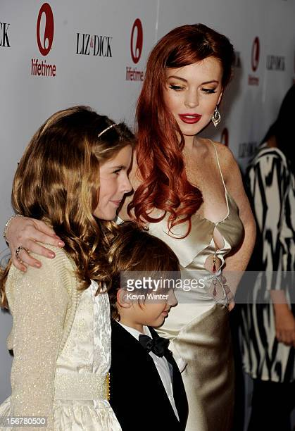 Actors Taylor Ann Thompson Trevor Thompson and Lindsay Lohan arrive at a party to celebrate Lifetime's Liz Dick at the Beverly Hills Hotel on...
