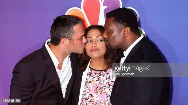 Actors Taylor Kinney Monica Raymund and Eamonn Walker from Chicago Fire attends the 2014 NBC Upfront Presentation at The Jacob K Javits Convention...