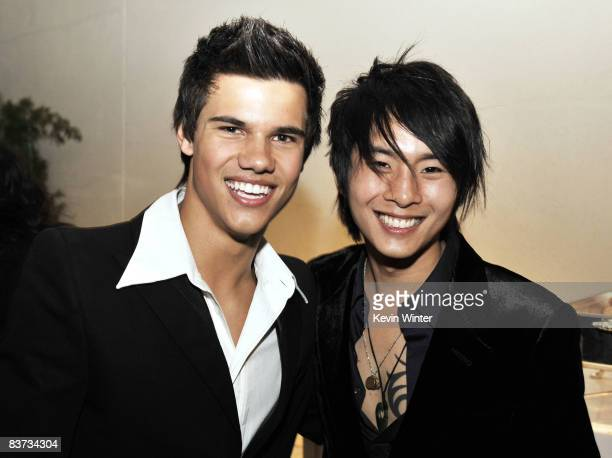 Actors Taylor Lautner and Justin Chon pose at the afterparty for the premiere of Summit Entertainment's Twilight at the Armand Hammer Museum on...