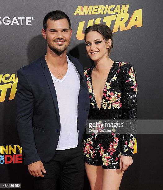 Actors Taylor Lautner and Kristen Stewart arrive at the premiere of Lionsgate's 'American Ultra' at Ace Theater Downtown LA on August 18 2015 in Los...