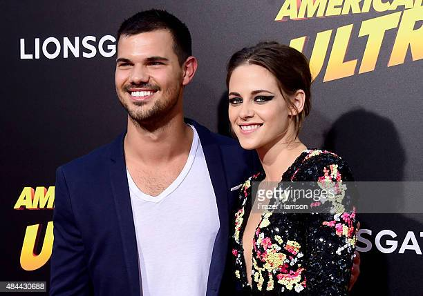 Actors Taylor Lautner and Kristen Stewart attend PalmStar Media And Lionsgate's 'American Ultra' premiere at the Ace Theater Downtown LA on August 18...