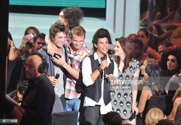 Actors Taylor Lautner and Kristen Stewart on stage at the 2008 MTV Video Music Awards at Paramount Pictures Studios on September 7 2008 in Los...