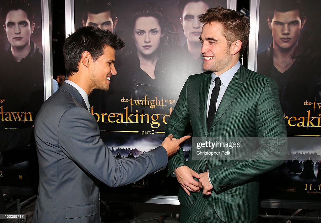 Actors Taylor Lautner (L) and Robert Pattinson arrive at the premiere of Summit Entertainment's 'The Twilight Saga: Breaking Dawn - Part 2' at Nokia Theatre L.A. Live on November 12, 2012 in Los Angeles, California.