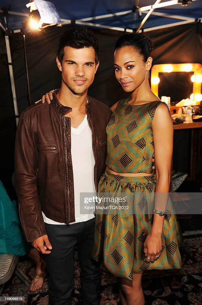 Actors Taylor Lautner and Zoe Saldana attend the 2012 Teen Choice Awards at Gibson Amphitheatre on July 22, 2012 in Universal City, California.