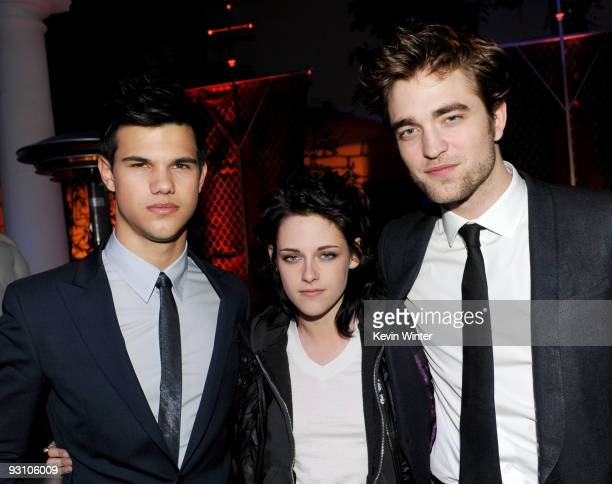 Actors Taylor Lautner Kristen Stewart and Robert Pattinson arrive at the afterparty for the premiere of Summit Entertainment's The Twilight Saga New...