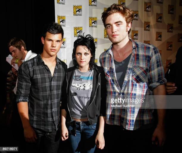 Actors Taylor Lautner Kristen Stewart and Robert Pattinson attend 'The Twilight Saga New Moon' Summit Entertainment panel during ComicCon 2009 held...