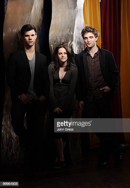 Actors Taylor Lautner Kristen Stewart and Robert Pattinson pose for a private photo shoot at Marche on May 5 2010 in Chicago Illinois