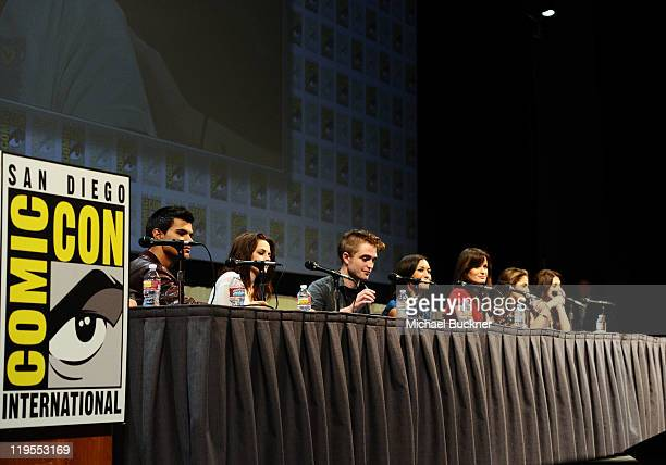 Actors Taylor Lautner Robert Pattinson Kristen Stewart Ashley Greene Julia Jones Nikki Reed and Elizabeth Reaser pose onstage at Summit Entertainment...