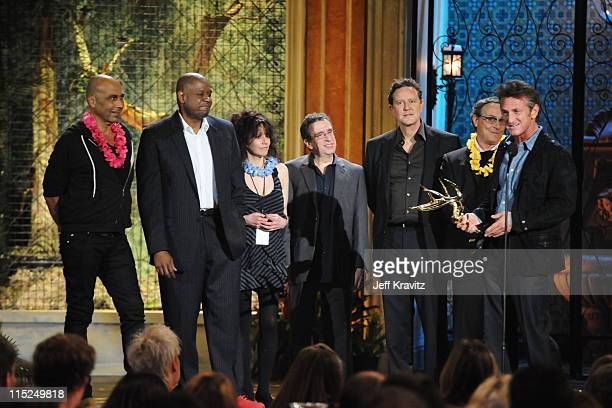 Actors Taylor Negron Forest Whitaker director Amy Heckerling actors Brian Backer Judge Reinhold Robert Romanus and Sean Penn accept an award onstage...
