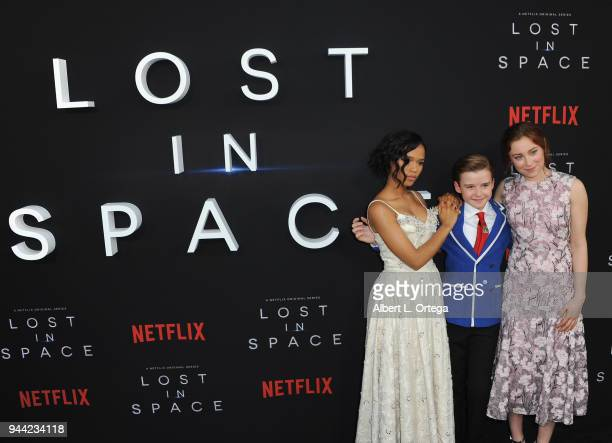 Actors Taylor Russell Maxwell Jenkins and Mina Sundwall arrive for the Premiere Of Netflix's Lost In Space Season 1 held at The Cinerama Dome on...