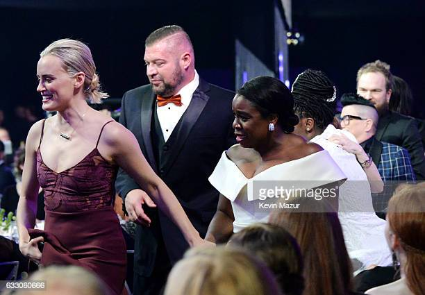 Actors Taylor Schilling Brad William Henke and Uzo Aduba walk to stage during The 23rd Annual Screen Actors Guild Awards at The Shrine Auditorium on...
