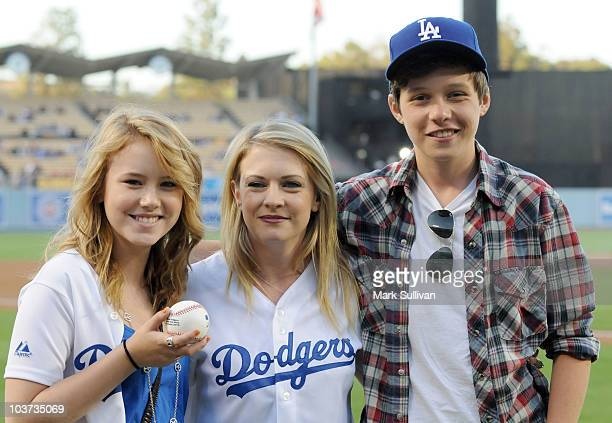 Actors Taylor Spreitler Melissa Joan Hart and Nick Robinson prior to the Los Angeles Dodgers vs Philadelphia Phillies game at Dodger Stadium on...