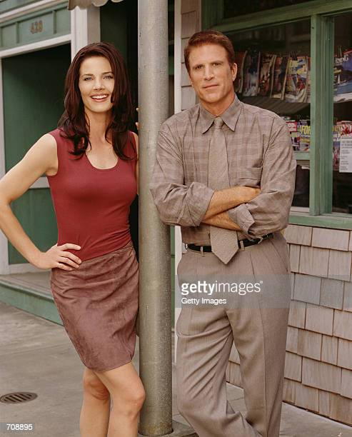 """Actors Ted Danson and Terry Farrell from the CBS television show """"Becker"""" pose for a photo."""