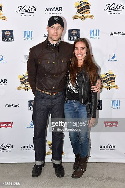 Actors Teddy Sears and Melissa Sears attend Kiehl's LifeRide Finale Event on August 12 2014 in New York City