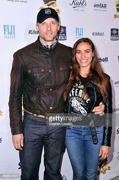 Actors Teddy Sears and Melissa Sears attend Kiehl's LifeRide for amfAR cohosted by FIJI Water on August 12 2014 in New York City