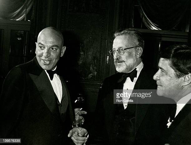Actors Telly Savalas and George C. Scott attend Golf Collegiate Dinner Gala on August 15, 1979 at the Waldorf Hotel in New York City.