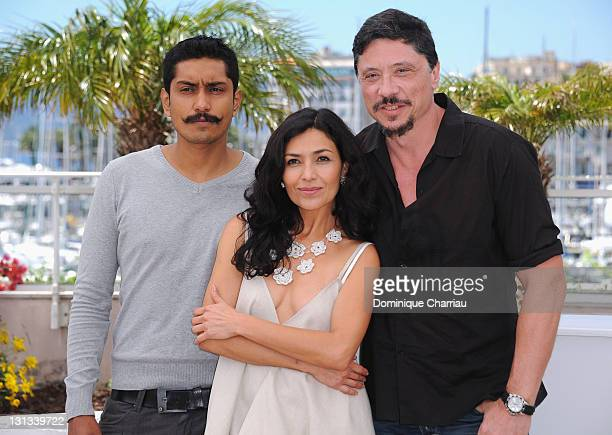 Actors Tenoch Huerta Dolores Heredia and actor Carlos Bardiem attend the 'Dias De Gracia' Photocall at the Palais des Festivals during the 64th...
