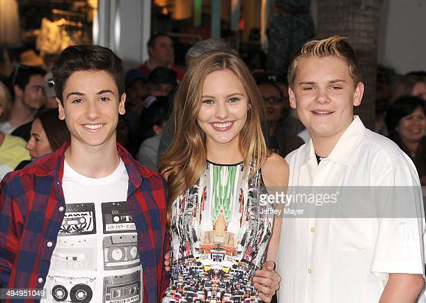 Actors Teo Halm Ella Wahlestedt and Reese C Hartwig arrive at the Los Angeles premiere of 'Million Dollar Arm' at the El Capitan Theatre on May 6...