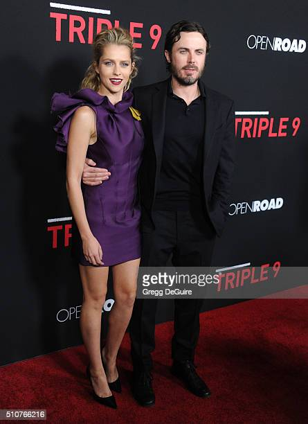 Actors Teresa Palmer and Casey Affleck arrive at the premiere of Open Road's 'Triple 9' at Regal Cinemas LA Live on February 16 2016 in Los Angeles...