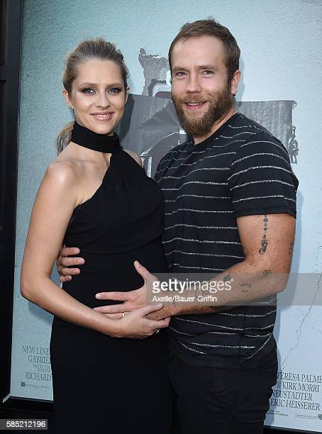 Actors Teresa Palmer and Mark Webber arrive at the premiere of New Line Cinema's 'Lights Out' at TCL Chinese Theatre on July 19 2016 in Hollywood...