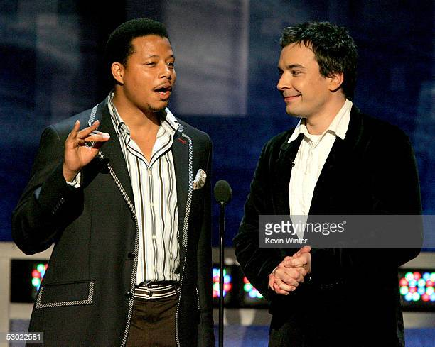 Actors Terrence Howard and Jimmy Fallon speak onstage during the 2005 MTV Movie Awards at the Shrine Auditorium on June 4 2005 in Los Angeles...