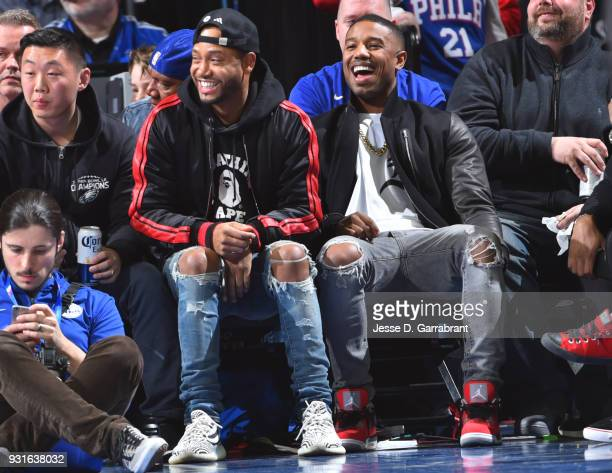 Actors Terrence J and Michael B Jordan looks on during the Philadelphia 76ers against the Indiana Pacers at the Wells Fargo Center on March 13 2018...