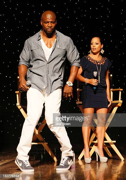 Actors Terry Crews and Essence Atkins of the TBS show 'Are We There Yet' dance onstage during a VIP screening at the TNT 2011 Essence Festival Day 2...