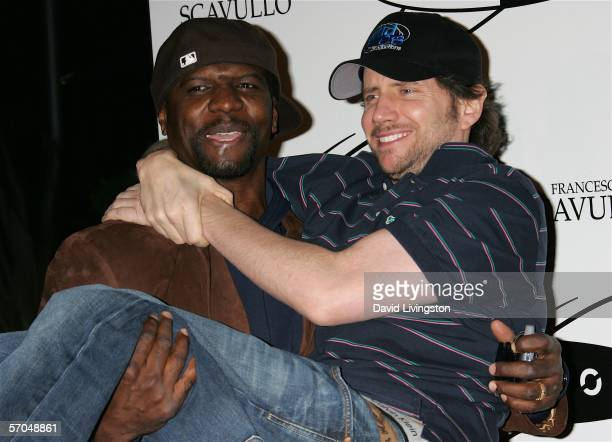 Actors Terry Crews and Jamie Kennedy pose at the grand opening of Equinox Fitness Club on March 9 2006 in Westwood California