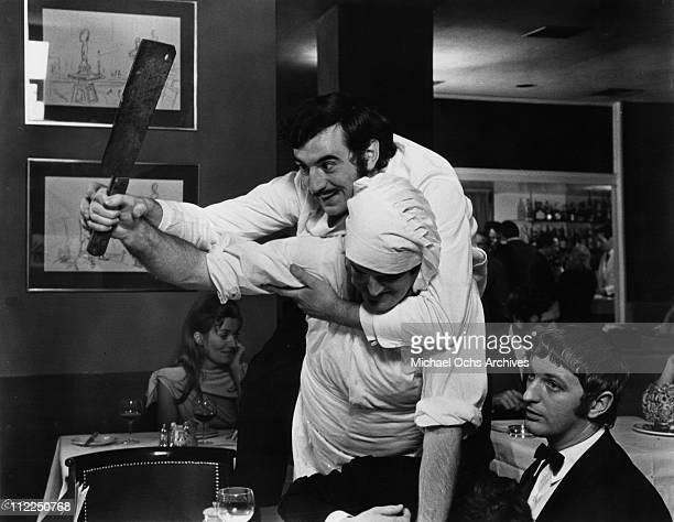 Actors Terry Jones John Cleese and Graham Chapman in a scene from the movie 'And Now For Something Completely Different' in 1971 in England