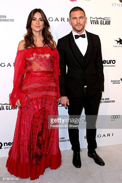 Actors Thalia Ayala and Adam Senn attend the 24th Annual Elton John AIDS Foundation's Oscar Viewing Party on February 28 2016 in West Hollywood...