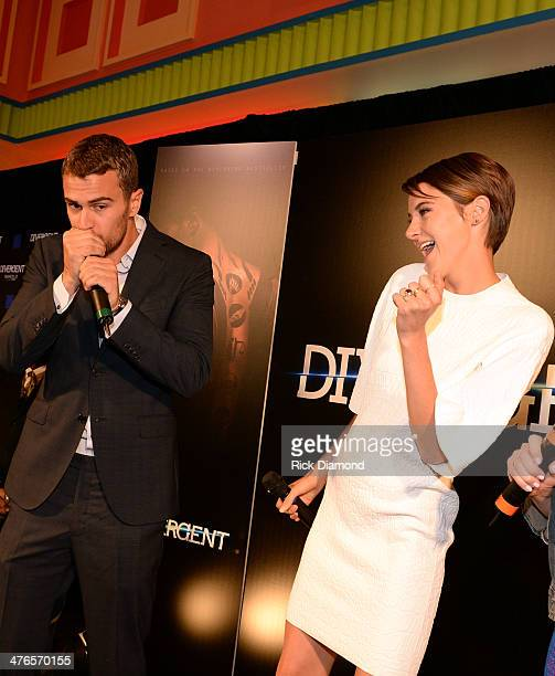 Actors Theo James and Shailene Woodley of Divergent makes a personal appearance at Regal Atlantic Station on March 3 2014 in Atlanta Georgia