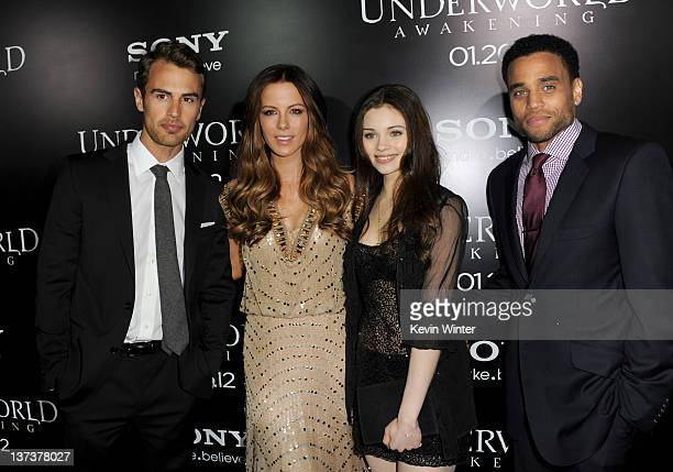 Actors Theo James Kate Becksinsale India Eisley and Michael Ealy arrive at the premiere of Screen Gems' Underworld Awakening at Grauman's Chinese...