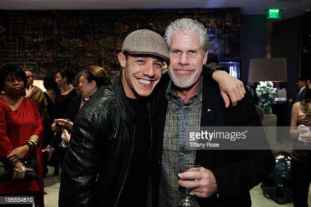 Actors Theo Rossi and Ron Perlman attend the Opal Stone Luxury Handbags And Fine Jewelry Launch at Gray Gallery on December 8 2011 in Beverly Hills...