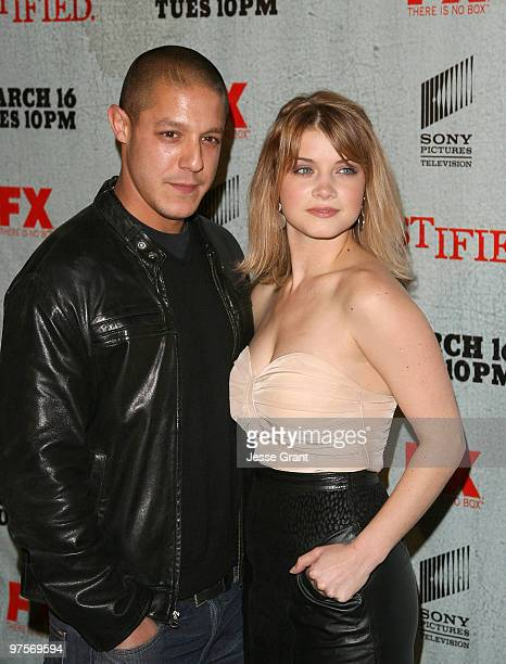 Actors Theo Rossi and Sarah Jones arrives at the Justified Premiere Screening at the Directors Guild Theatre on March 8 2010 in Los Angeles California