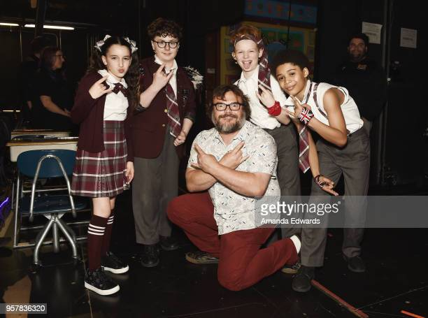 Actors Theodora Silverman Theo MitchellPenner Jack Black and Gilberto MorettiHamilton pose backstage after a performance of 'School Of Rock' attended...