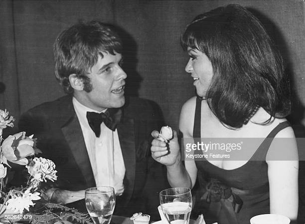 Actors Thomas Fritsch and Marie Versini talking at their table at the Bambi Awards Germany January 20th 1968