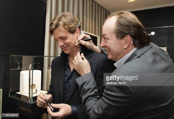 Actors Thomas Heinze and Herbert Knaup attend the Montblanc boutique reopening at the Friedrichstrasse on April 28 2011 in Berlin Germany