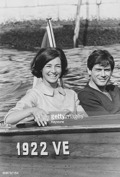 Actors Thomas Milian and Emmanuelle Riva smiling as they take a tour on a motor boat during a visit to the Venice Film Festival Italy September 3rd...