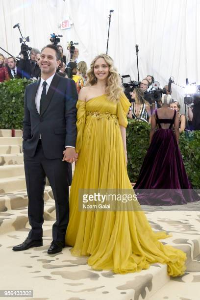 Actors Thomas Sadoski and Amanda Seyfried attend the Heavenly Bodies Fashion The Catholic Imagination Costume Institute Gala at The Metropolitan...
