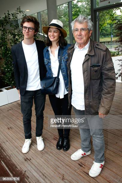 Actors Thomas Soliveres his companion Lucie Boujenah and her uncle Michel Boujenah attend the 2018 French Open Day Three at Roland Garros on May 29...