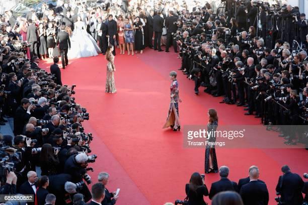 Actors Thylane Blondeau Li Yuchun and Julianne Moore attend the 'Okja' premiere during the 70th annual Cannes Film Festival at Palais des Festivals...