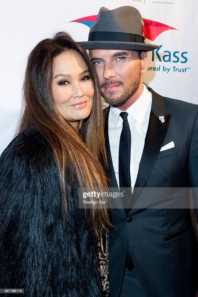 Actors Tia Carrere (L) and Matt Goss attend the Beverly Hills Chamber of Commerce hosting