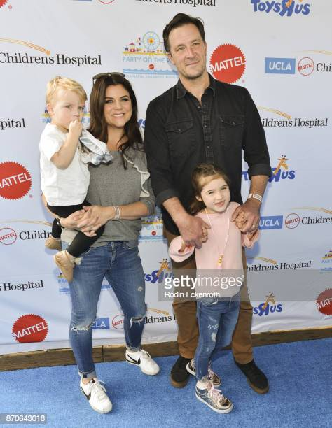 Actors Tiffani Thiessen and Brady Smith with their children Holt Fisher Smith and Harper Renn Smith attend the 18th Annual Mattel Party on the Pier...