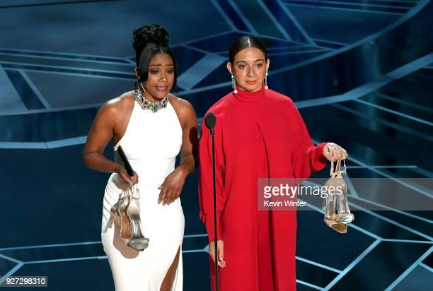 Actors Tiffany Haddish and Maya Rudolph speak onstage during the 90th Annual Academy Awards at the Dolby Theatre at Hollywood Highland Center on...