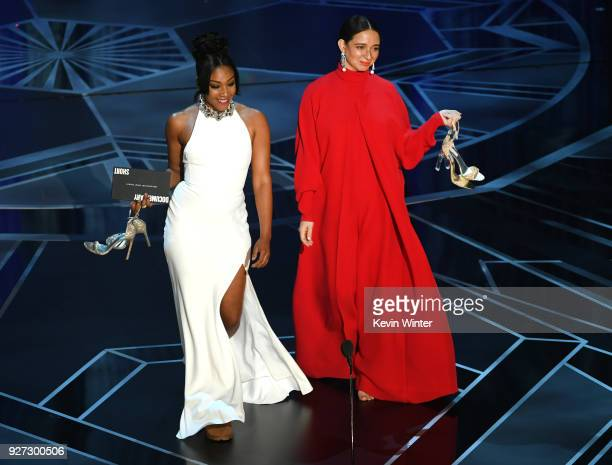 Actors Tiffany Haddish and Maya Rudolph walk onstage during the 90th Annual Academy Awards at the Dolby Theatre at Hollywood Highland Center on March...