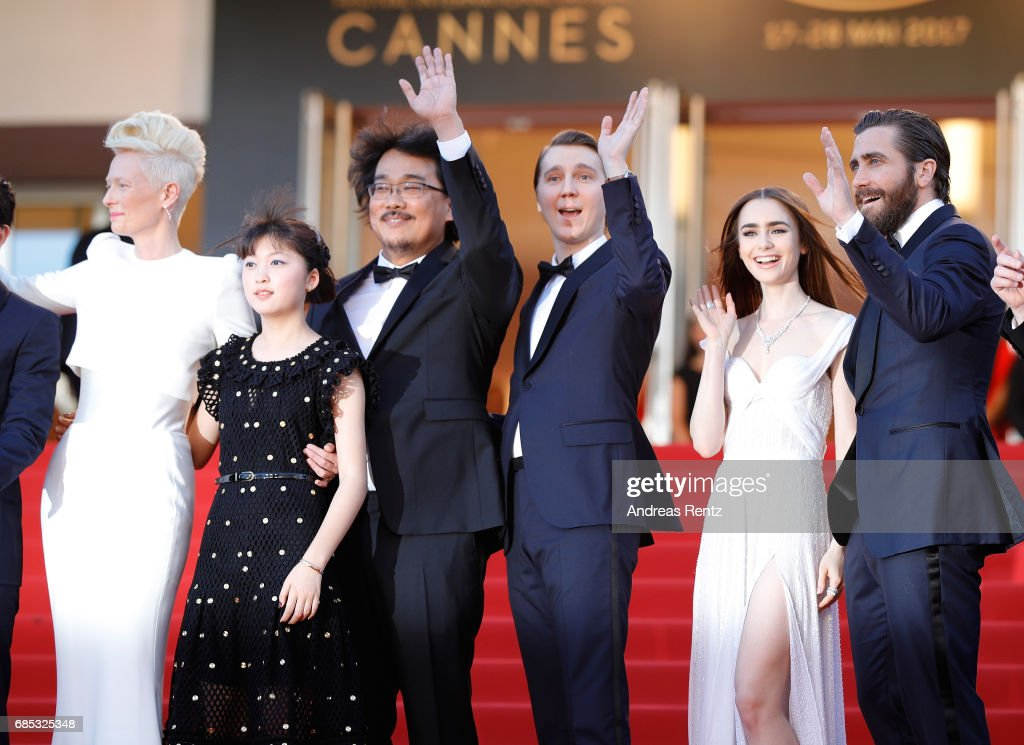Actors Tilda Swinton and Ahn Seo-Hyun, director Bong Joon-Ho, actors Paul Dano, Lily Collins and Jake Gyllenhaal attend the 'Okja' screening during the 70th annual Cannes Film Festival at Palais des Festivals on May 19, 2017 in Cannes, France.