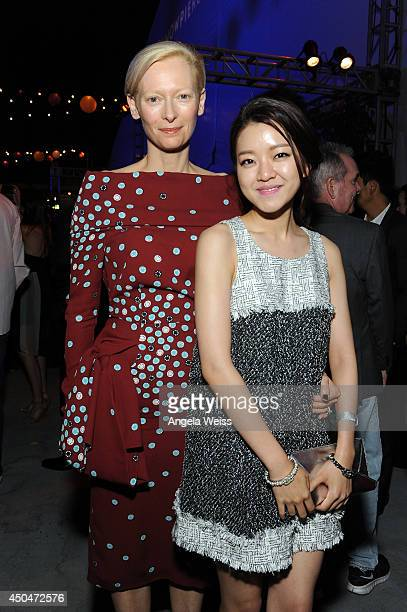 """Actors Tilda Swinton and Ah-sung Ko attend the after party for the opening night premiere of """"Snowpiercer"""" during the 2014 Los Angeles Film Festival..."""
